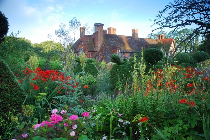 The historic house and landscaped garden at Great Dixter, created by garden designer Christopher Lloyd around the historic 15th century house. Bold colours and planting.